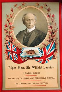 Wilfrid Laurier's election poster. The colour poster features an oval portrait of Wilfrid surrounded by a crown of maple leaves. Under the portrait, the flag of Great Britain and the first Canadian flag. Between the two, a beaver. At the bottom, the title of the poster.